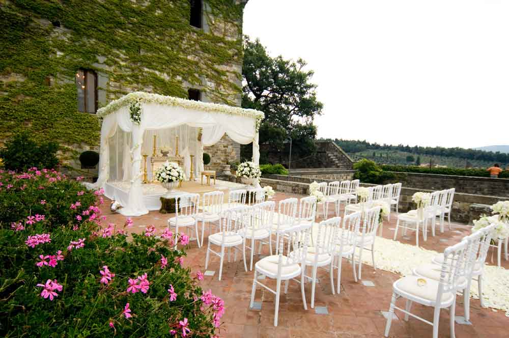 romantic ceremony castle tuscany white drape and flowers