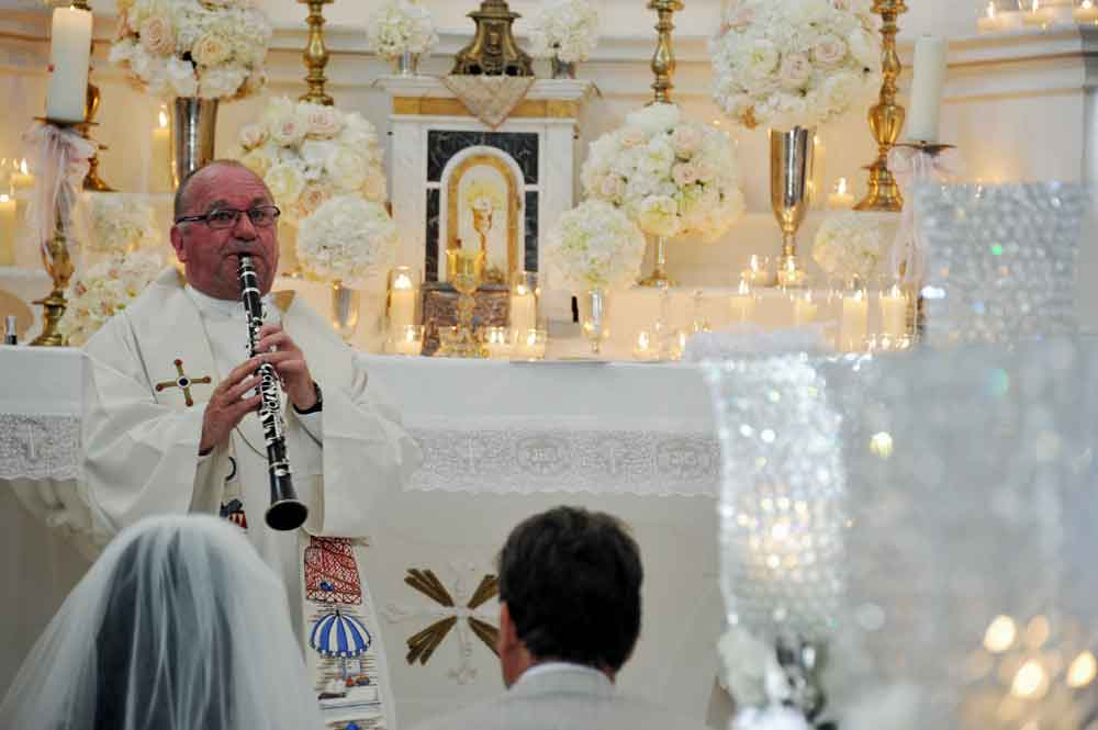 thh best priest ever clarinet priest player ceremony tuscan retreat destination weddings catholic