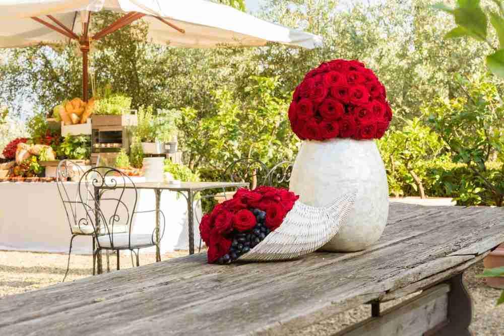 red roses reception decor Tuscan villa